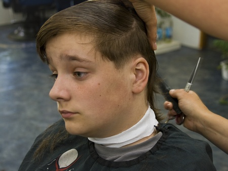 Boy having a hair cut at the hairdressers Stock Photo - 11089891