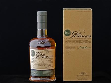 Kiev, Ukraine - June 18, 2011: Bottle and box of 12 years old single malt scotch whisky Glen Garioch against black background