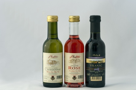 Kiev, Ukraine - July 09, 2011: Three small bottles of Montenegro wine (white, rose and red) against white background. Stock Photo - 11215280