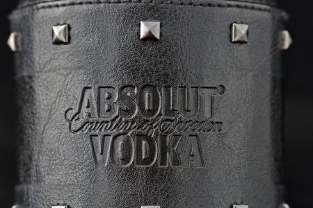 Kiev, Ukraine - June 05, 2011: Absolut Vodka Rock Edition symbol on black leather surface. Stock Photo - 11215281