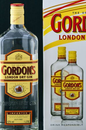 litre: Kiev, Ukraine - June 05, 2011: Special London Dry Gin 1 litre bottle and pack against black background. Editorial