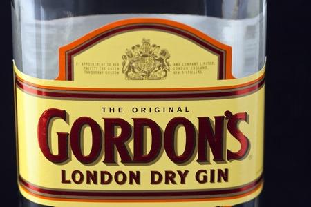 Kiev, Ukraine - June 05, 2011: Special Gordons London Dry Gin bottle label against black background.