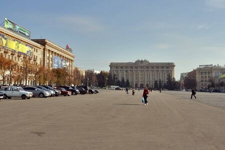 Kharkov, Ukraine - October 27, 2011: Pedestrians walk on Freedom Square at sunny day in Kharkov, Ukraine.