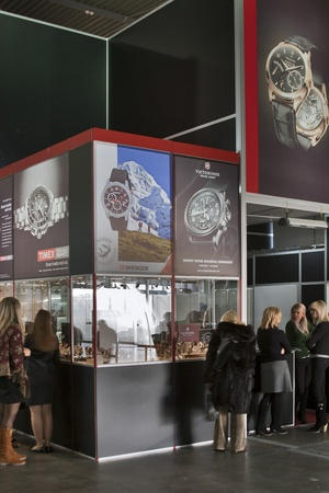 KIEV, Ukraine - November 17: Visitors visit Victorinox, Timex and Wenger watches booth at Autumn Jeweller Expo Exhibition at KyivExpoPlaza Exhibition Center on November 17, 2011 in Kiev, Ukraine.