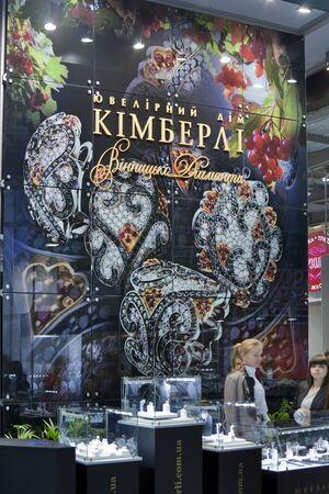 KIEV, UKRAINE - NOVEMBER 17: Presenters of Kimberli Jeweller House booth during Autumn Jeweller Expo exhibition at KyivExpoPlaza Exhibition Center on November 17, 2011 in Kiev, Ukraine.