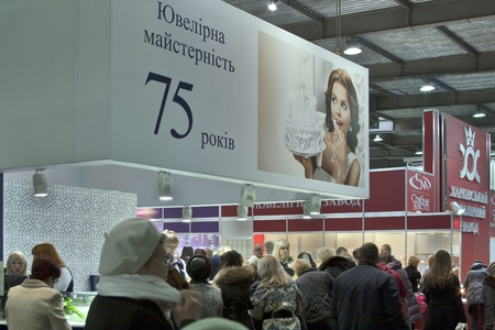 KIEV, UKRAINE - NOVEMBER 17: Visitors visit Kyiv Jewellery Factory (founded 1936) booth during Autumn Jeweller Expo exhibition at KyivExpoPlaza Exhibition Center on November 17, 2011 in Kiev, Ukraine.  Stock Photo - 11691581