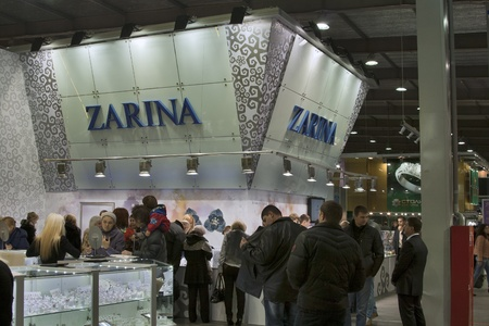 KIEV, UKRAINE - NOVEMBER 17: Visitors visit Jeweller House ZARINA booth during Autumn Jeweler Expo exhibition at KyivExpoPlaza Exhibition Center on November 17, 2011 in Kiev, Ukraine. The Jewellery House ZARINA is one of the most famous and bright brands  Stock Photo - 11691587