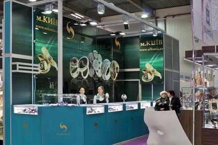 KIEV, UKRAINE - NOVEMBER 17: Visitors visit Vinnitsa Solomia Jewelry company booth during Autumn Jeweler Expo exhibition at KyivExpoPlaza Exhibition Center on November 17, 2011 in Kiev, Ukraine.