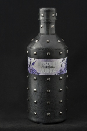 Kiev, Ukraine - June 05, 2011: Absolut Vodka Rock Edition black leather cover against black background in Kiev, Ukraine.