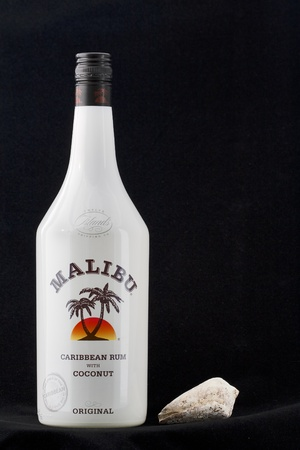 Kiev, Ukraine - August 27, 2011: Bottle of Malibu Caribbean Rum against black background in Kiev, Ukraine.
