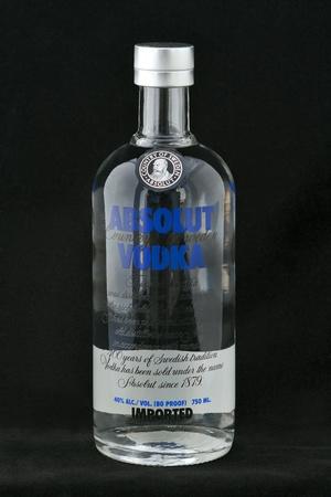 Kiev, Ukraine - June 05, 2011: Absolut Vodka bottle against black background in Kiev, Ukraine. Stock Photo - 12272776