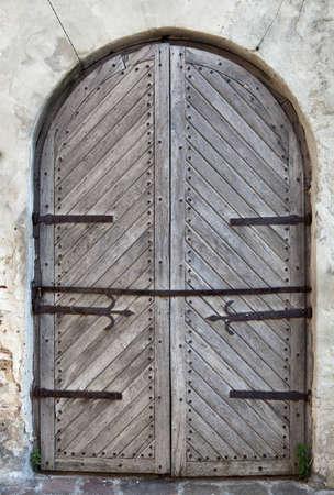 Moody door of old castle