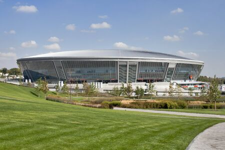adulation: Donetsk, Ukraine - September 17, 2010: facade of newly built Donbass Arena football stadium and park at sunny day.The Donbass Arena stadium hosts Football Club Shakhtar Donetsk and will host UEFA EURO Championship in 2012.