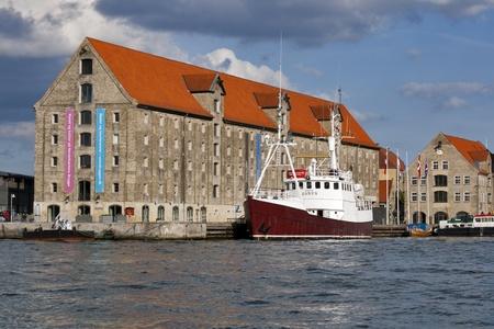janus: Copenhagen, Denmark - 29 May, 2010: Channel view of Noma restaurant and moored Arctic Janus ship in Copenhagen, Denmark.