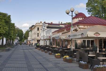 JURMALA, LATVIA - JUNE 2: Pedestrians walk around Jomas Street at summer day on June 2, 2012 in Jurmala, Latvia. Jomas Street in Jurmala is one of the central and oldest streets of Jurmala with restaurants, summer terraces, hotels and cafes.