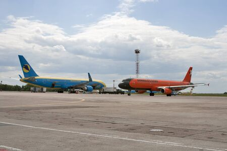 Kiev, Ukraine - May 31, 2012: Airbus A-320 and Boeing 737-800 jet aircrafts of Donbassaero and Aerosvit Ukrainian airlines parked in Boryspil International Airport in Kiev, Ukraine. Stock Photo - 14312051