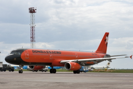 KIEV, UKRAINE - MAY 31: Donbassaero airlines Airbus A320 jet aircraft parked in Boryspil International Airport on May 31, 2012 in Kiev, Ukraine. Stock Photo - 14312050