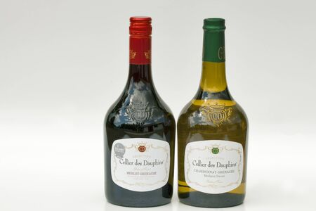Kiev, Ukraine - June 29, 2012: Set of bottles of Rhone French red and white Selection wines Cellier des Dauphins against white background. Cellier des Dauphins is a cooperative group that is the result of the union of 13 Cooperative Wine cellars from the