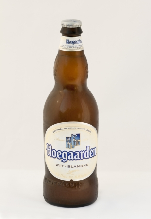 Hoegaarden wheat Belgian beer cold bottle against white background. The Belgian village of Hoegaarden had been known for its white beers since the Middle Ages. Hoegaarden wheat Belgian beer first brewed in 1445 is spiced with coriander and orange peel. It