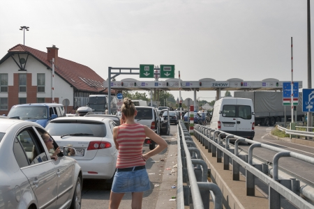 Zahony, Hungary - August 05, 2012: Traffic jams on the Ukrainian-Hungarian border (between Chop and Zahony) customs checkpoint on bridge over Tisa river in Zahony, Hungary.