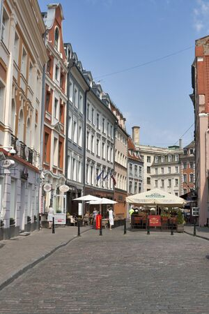 baltic people: Riga, Latvia - July 29,2012: People walk and have fun at old street with cafe in the Old City in Riga Latvia. Riga is the capital and largest city of Latvia. With 700 000 inhabitants. Riga is the largest city of the Baltic states, one of the largest citie