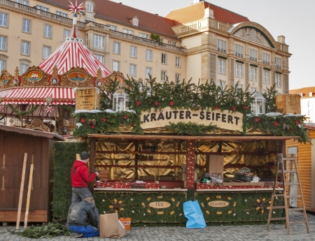 Dresden, Germany - November 14, 2012: Unrecognized workers prepare Christmas tent on old Square Altmarkt for Striezelmarkt, one of Germanys oldest Christmas markets with a very long history dating back to 1434, in Dresden, Germany.