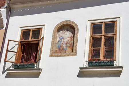 House outdoor wall with fresco and windows in Zagreb, Croatia. photo