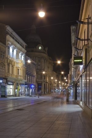ZAGREB, CROATIA - AUGUST 21: People walk at night along Ilica street on August 21, 2012 in Zagreb, Croatia. Ilica street is one of the longest streets in Zagreb and considered to be the most expensive residential street in the city.