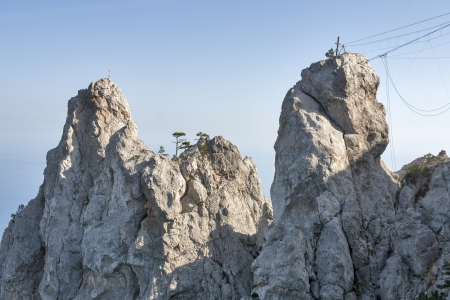 rappelling: Two cliffs and equipment for mountain climbing and rappelling fixed on the rock  Ai-Petri, Crimea, Ukraine