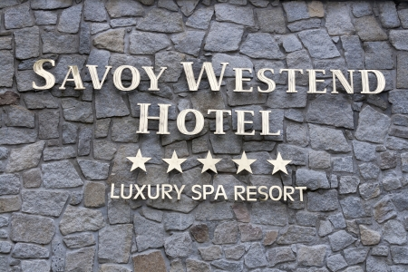 westend: KARLOVY VARY, CZECH REPUBLIC - NOVEMBER 13: Luxury spa resort Savoy Westend Hotel sign on stone wall on November 13, 2012 in Karlovy Vary, Czech Republic. Old hotel underwent thorough costly reconstruction in 2004-05, and was opened to the public in its n