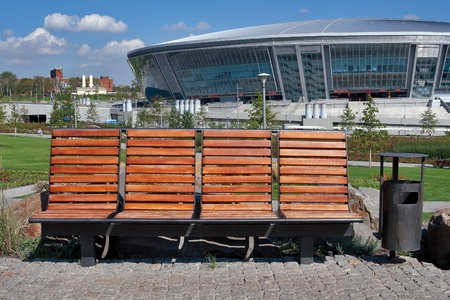 donbass: DONETSK, UKRAINE - SEPTEMBER 17: Bench in front of Donbass Arena on September 17, 2010 in Donetsk, Ukraine. With a capacity of 50,000 spectators, the Stadium hosts FC Shakhtar Donetsk matches and will host some matches in Euro 2012.