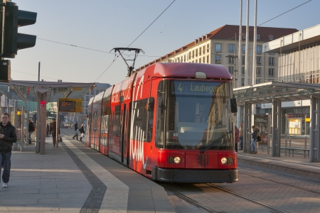 tramline: DRESDEN, GERMANY - NOVEMBER 14: A DWS 6-axle car at a tram stop with passengers on Novemner 14, 2012 in Dresden, Germany. DVB is the municipal transport company which operate twelve routes on a 200 km network, with a fleet of 160 tramsets. Editorial