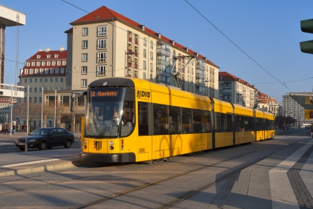 tramline: DRESDEN, GERMANY - NOVEMBER 14: A DWS 6-axle car at city street on November 14, 2012 in Dresden, Germany. DVB is the municipal transport company which operate twelve routes on a 200 km network, with a fleet of 160 tramsets.