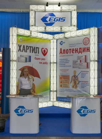 pharm: KIEV, UKRAINE - September 27: Presenter work on booth of EGIS Hungarian generic pharmaceutical products company during XIII National Congress of Cardiology on September 27, 2012 in Kiev, Ukraine.