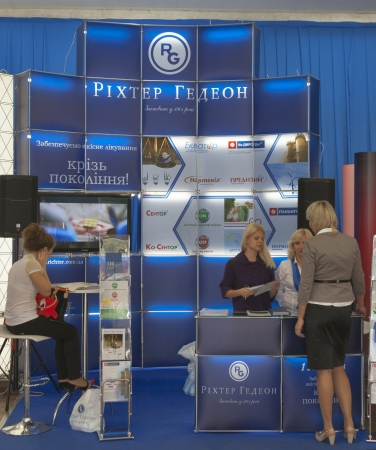pharm: KIEV, UKRAINE - September 27: Presenters work on booth of Gedeon Richter Plc. largest pharmaceutical factory in Hungary during XIII National Congress of Cardiology on September 27, 2012 in Kiev, Ukraine.