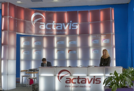 pharmaceutical company: KIEV, UKRAINE - September 27: Presenters work on booth of Actavis, Inc., a global integrated specialty pharmaceutical company during XIII National Congress of Cardiology on September 27, 2012 in Kiev, Ukraine.