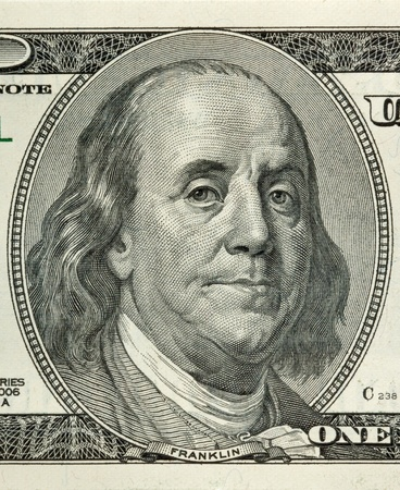 Portrait of Benjamin Franklin macro from one hundred dollars bill photo