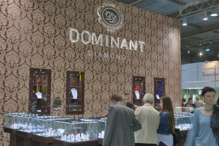 KIEV, UKRAINE - MAY 16: Visitors visit Dominant Diamonds Jewelry Company booth during Spring Jeweler Expo exhibition at KyivExpoPlaza Exhibition Center on May 16, 2012 in Kiev, Ukraine.