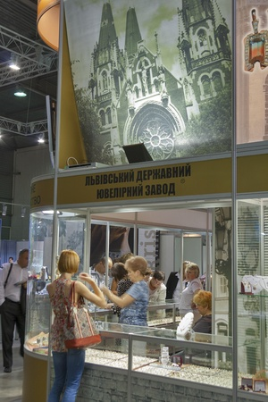 Kiev, Ukraine - May 16, 2012: Visitors visit Lviv State Jewelry Factory booth during Spring Jeweler Expo exhibition at KyivExpoPlaza Exhibition Center in Kiev, Ukraine.