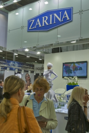Kiev, Ukraine - May 16, 2012: Visitors visit Zarina Jewelry House booth with presenters during Spring Jeweler Expo exhibition at KyivExpoPlaza Exhibition Center in Kiev, Ukraine.