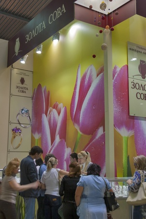 Kiev, Ukraine - May 16, 2012: Visitors visit Golden Age Jewelry Company (founded in 2000) booth during Spring Jeweler Expo exhibition at KyivExpoPlaza Exhibition Center in Kiev, Ukraine.