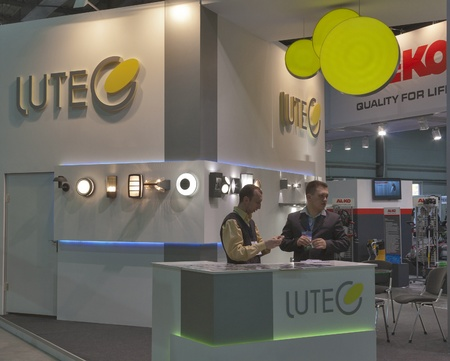 Kiev, Ukraine - March 30, 2012: Presenters work at Lutec Australian company booth during 3rd International forum of building materials and technologies INTERBUDEXPO 2012 at KyivExpoPlaza Exhibition Center on March 30, 2012 in Kiev, Ukraine. The Lutec 1000