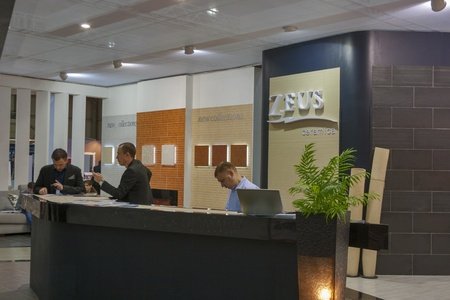 ceramica: Kiev, Ukraine - March 30, 2012: Presenters work at Zeus Ceramica Ukrainian company booth during 3rd International forum of building materials and technologies INTERBUDEXPO 2012 at KyivExpoPlaza Exhibition Center on March 30, 2012 in Kiev, Ukraine. Zeus is