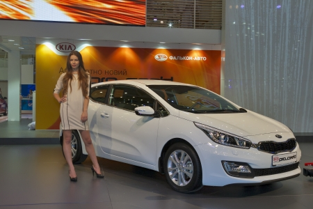 proceed: KIEV, UKRAINE - MAY 29: Presenter work on display of new Korean car model KIA Pro_Ceed at SIA 2013 Kyiv International Motor Show in International Exhibition Centre on May 29, 2013 in Kiev, Ukraine.
