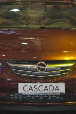 KIEV, UKRAINE - MAY 29: New vinous German car model Opel Cascada closeup hood on display of SIA' 2013 The 21st Kyiv International Motor Show in International Exhibition Centre on May 29, 2013 in Kiev, Ukraine.
