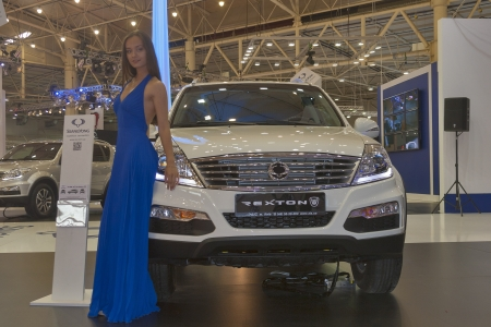 KIEV, UKRAINE - MAY 29: Presenter work on SsangYong booth with Korean car model Rexton on display of SIA 2013 The 21st Kyiv International Motor Show in International Exhibition Centre on May 29, 2013 in Kiev, Ukraine.