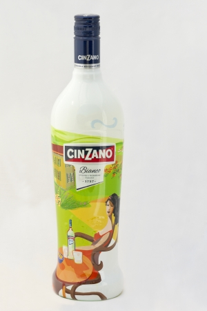 Kiev, Ukraine - August 26, 2012: Bottle of Italian Cinzano Bianco vermouth isolated on white background in Kiev, Ukraine. Cinzano is a recipe that dates back to 1757, a range of vermouths that are fortified Italian white and red wines infused with herbs a