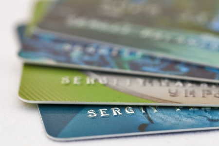Credit bank cards macro against white background Archivio Fotografico