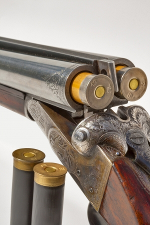 vintage rifle: hunting vintage rifle charged with additional cartridges macro Stock Photo
