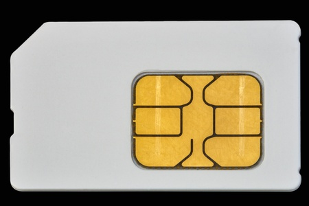 used mobile phone sim card macro isolated on black photo
